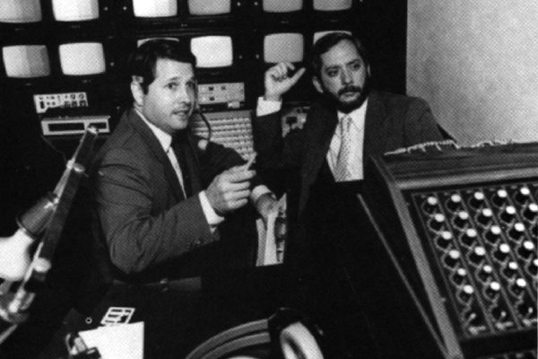 Cameron James (left) and Ken Mills at work at The Media Group.